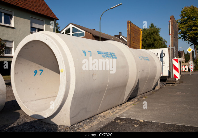 Sewage tube stock photos sewage tube stock images alamy sewage pipe in the street stock image sciox Images