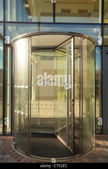Glass revolving door stock photos glass revolving door stock modern glass revolving doors at a modern property in norwich 3 st jamess court planetlyrics Image collections