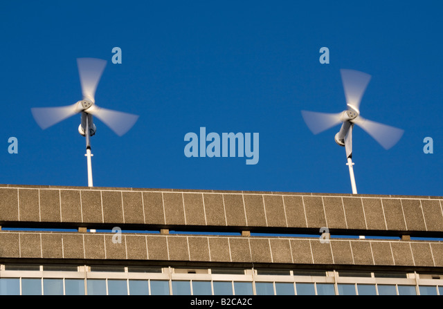 Wind Turbines On The Roof Of A Building In South London England Britain UK    Stock