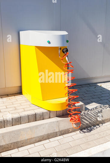 tire inflator gas station. air pump at the gas station in summer sunny day - stock image tire inflator