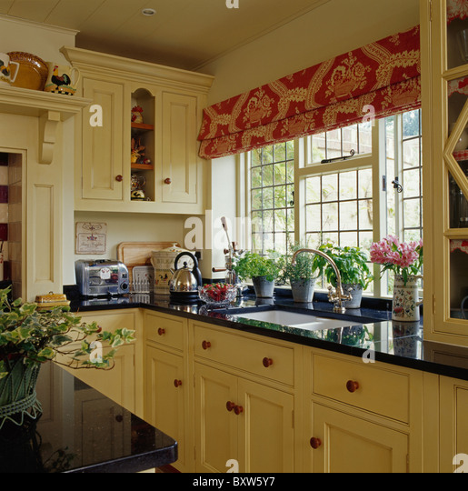 Interiors traditional kitchens neutral stock photos for Red fitted kitchen