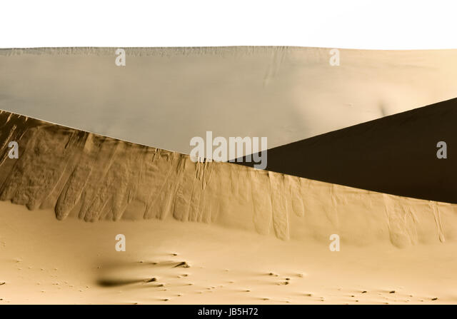 Big sand dune contrasts. Desert or beach sand textured background. - Stock Image