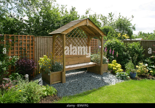 A New Pergola And Seat In A Landscaped Garden.   Stock Image