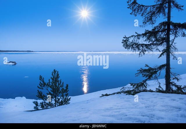 Seascape with moonlight at winter time - Stock Image