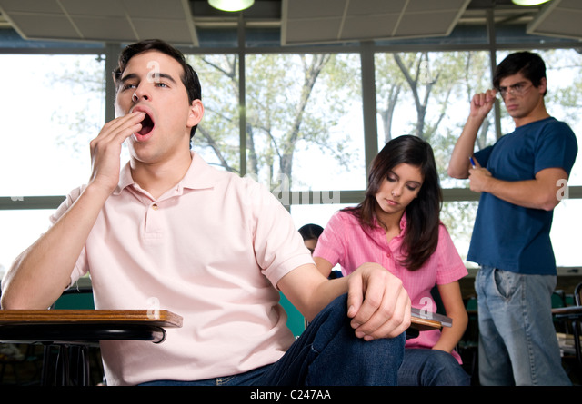 Girl yawning in class