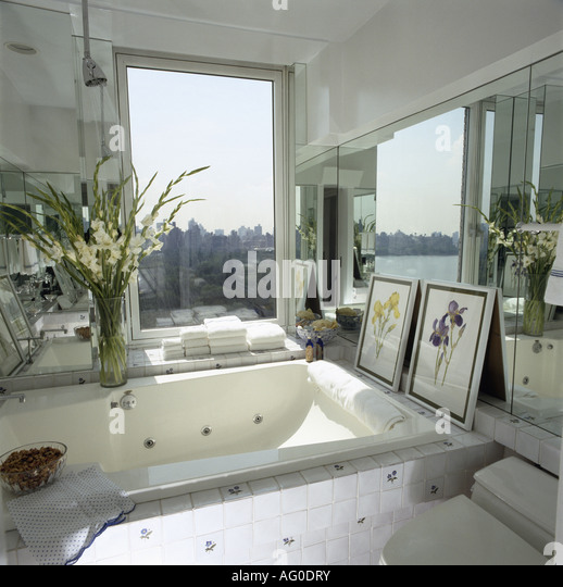 Wonderful Modern White Bathroom With Sunken Bath In Front Of Window With View Of The  City   Home Design Ideas