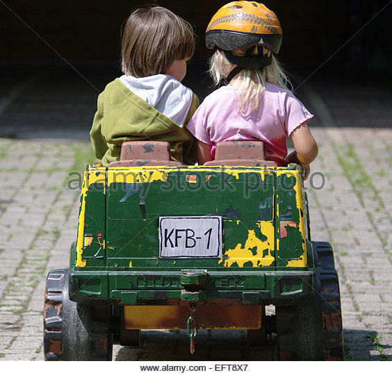 Riding Toys Age 5 : Year old child driving car stock photos