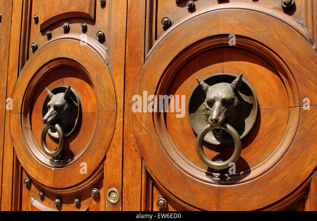 unusual door knockers on a door in verona italy stock image