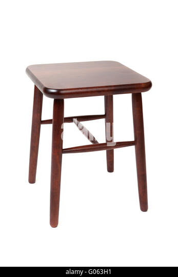 Brown wooden stool with four legs isolated on white - Stock Image