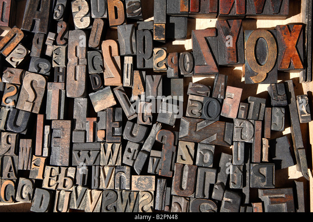 close up of old wooden letterpress printing letters stock image