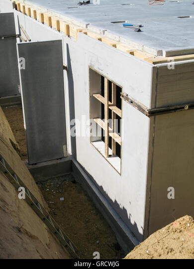 Building lot prefabricated house stock photos building for Prefab basement walls