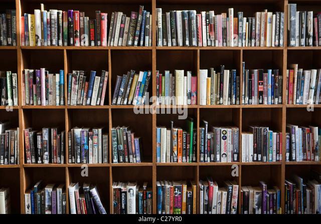 Library books on shelves. - Stock Image