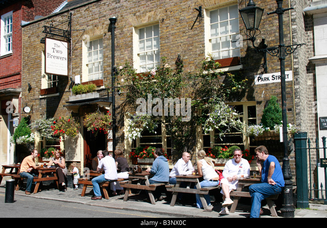 People Enjoying A Drink At The Two Brewers Pub In Park Street Windsor