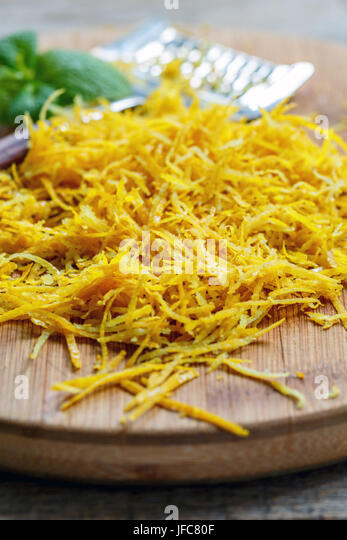 Lemon zest grated close up. - Stock Image