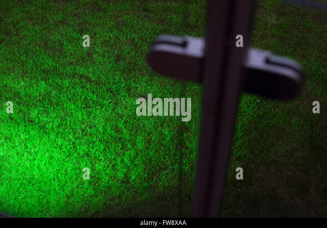 Bright green lighting casting a pool of light across the grass in a garden often & Bright Green Lighting Casting Pool Stock Photos u0026 Bright Green ... azcodes.com