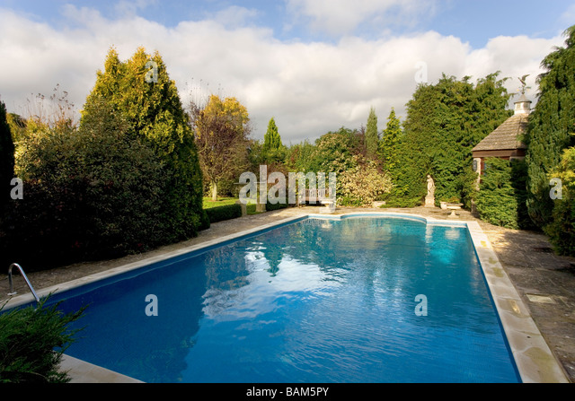 Outdoor swimming pool house uk stock photos outdoor for Hire a swimming pool for the garden