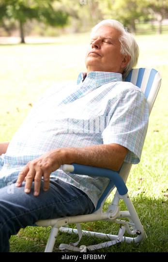 Senior Man Relaxing In Park   Stock Image