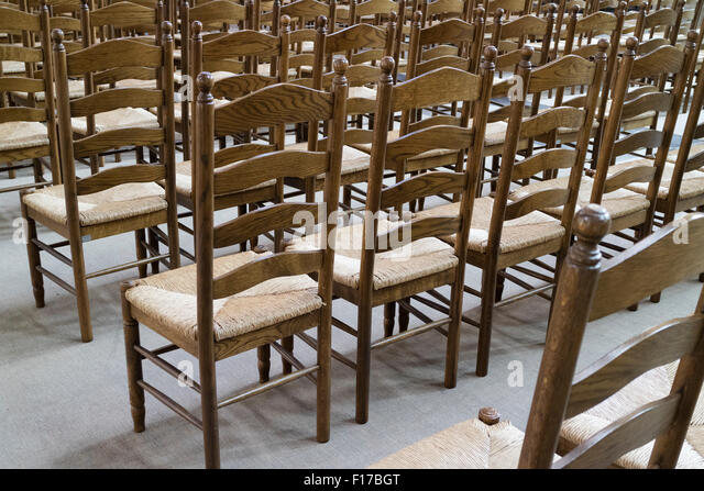 empty church chairs in the in ghend belgium stock image