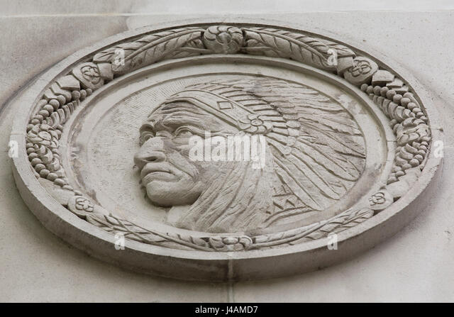 Depiction of a First Nations chief on the wall of the Fairmont Vancouver Hotel in Vancouver, Canada. - Stock Image