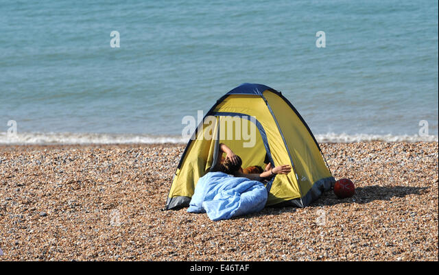 Brighton Sussex UK. 4th July 2014. Making the most of the & Tent Camping Brighton Beach Stock Photos u0026 Tent Camping Brighton ...
