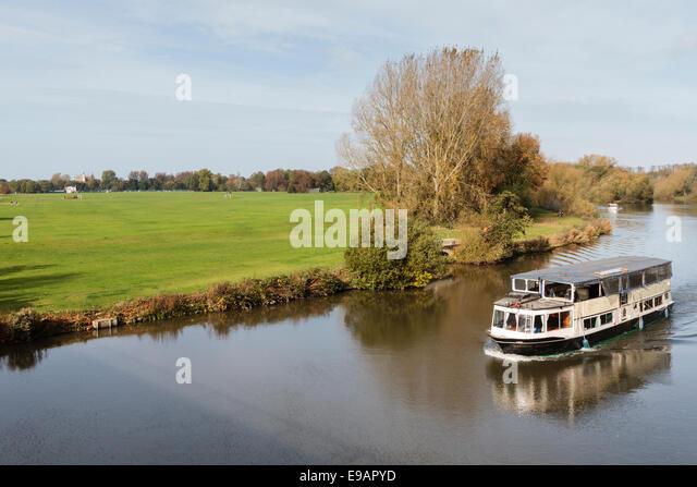 Boat On The River Thames Overlooking Home Park Windsor BerkshireEnglandUK