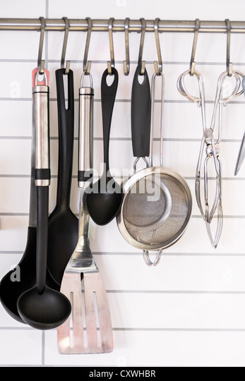 Kitchen Utilities Hanging On Hooks   Stock Image