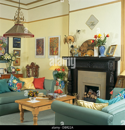 Blue Sofas And Pine Coffee Table In Pale Yellow Economy Style Townhouse Living Room With