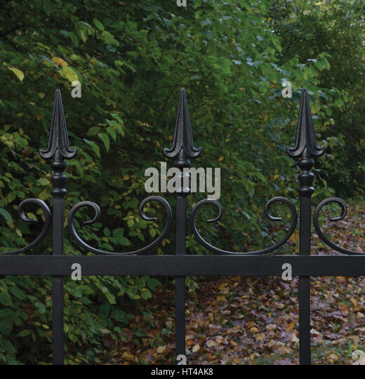 Ornate wrought iron fence stock photos