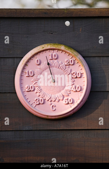 Garden Thermometer On A Fence At Dawn. Uk   Stock Image