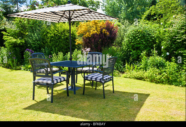 Stunning Lawn Furniture Stock Photos  Lawn Furniture Stock Images  Alamy With Inspiring Garden Furniture And Parasol Set Out On A Lawn In A Typical English Town Or  Country With Cool Bedford  Strand Covent Garden Also Rope Garden Edging In Addition Chiswick House Gardens And How To Build A Herb Garden As Well As Indian Restaurant Welwyn Garden City Additionally Apex Garden Sheds From Alamycom With   Inspiring Lawn Furniture Stock Photos  Lawn Furniture Stock Images  Alamy With Cool Garden Furniture And Parasol Set Out On A Lawn In A Typical English Town Or  Country And Stunning Bedford  Strand Covent Garden Also Rope Garden Edging In Addition Chiswick House Gardens From Alamycom