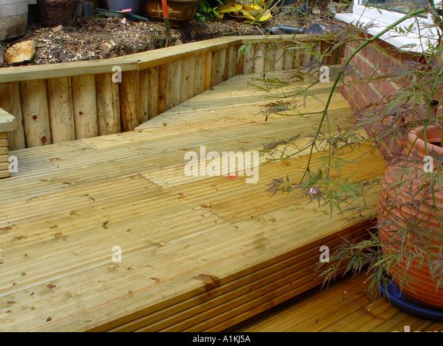 Patio Retaining Wall Construction Details : Log retaining wall stock photos