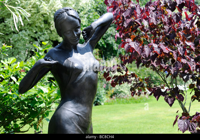 Statue Of A Woman In A Landscaped English Garden In Stoberry Park,  Somerset, UK