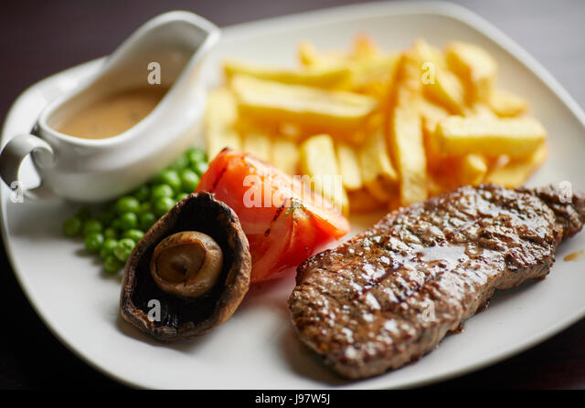 Traditional pub food, steak and chips. - Stock Image