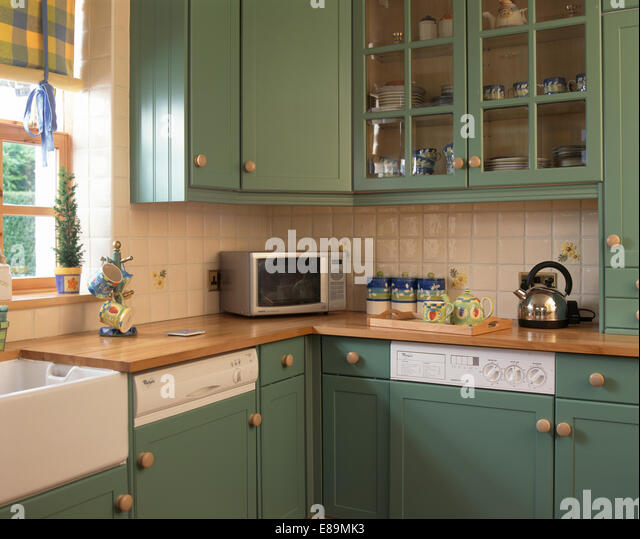 Wall cupboards stock photos wall cupboards stock images for Fitted kitchen cupboards
