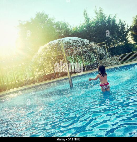 Little Girl Playing In Pool Stock Photos Little Girl Playing In Pool Stock Images Alamy