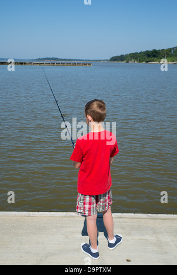 Boy fishing stock photos boy fishing stock images alamy for Fishing in williamsburg va