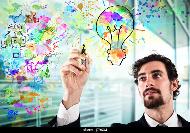 Businessman draws a creative business project - Stock Image