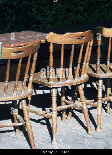 Old Fashioned Wooden Chairs By Table   Stock Image