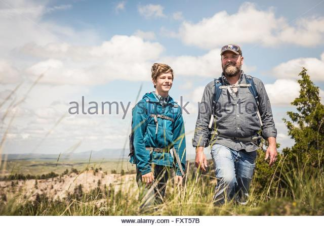 Father And Teenage Son Walking