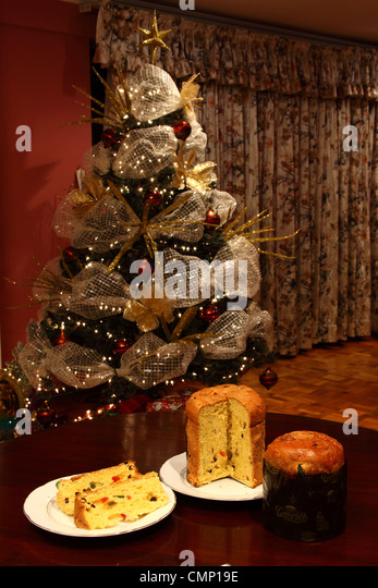 whole and sliced paneton an italian fruit bread popular at christmas in latin america