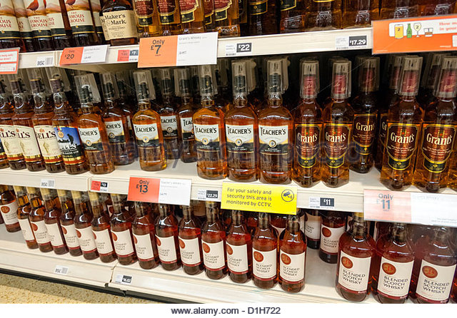 Bottles Of Whisky For Sale In A Sainsburys Supermarket Uk Stock Image
