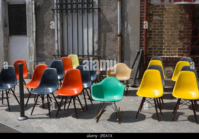 Colorful Plastic Chairs On The Sidewalk At An Outdoor Flea Market.   Stock  Image