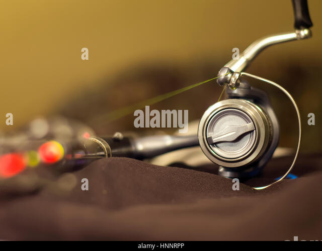 the reliable and high quality silver fishing reel stock image - Coloration Hnn