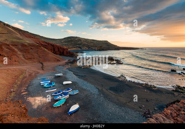 Volcanic Beach in El Golfo, Lanzarote, Canary Islands, Spain at sunset - Stock Image
