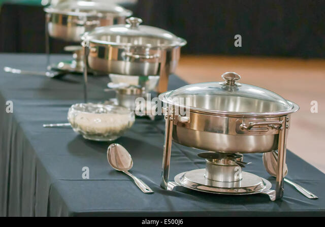 banquet table with chafing dish heaters stock image