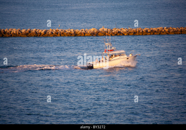 Speed boat beach stock photos speed boat beach stock for Fishing clearwater fl