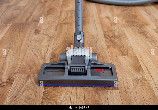 Laminate Floor Vacuum want to know about best vaccume cleaner for hardwood floor then visit our site at clean laminate flooringvacuum Vacuum Cleaner Used On A Parquet Wooden Floor Stock Image