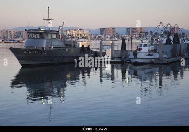 Charter fishing boat stock photos charter fishing boat for Deep sea fishing marina del rey