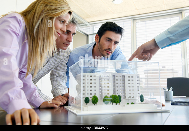 People Studying Architectural Model   Stock Image