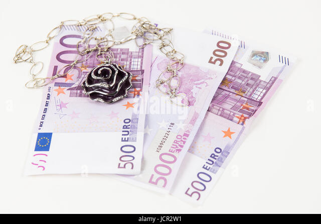 500 Euro bank notes and jewelry. Concept of consumerism and money spending - Stock Image